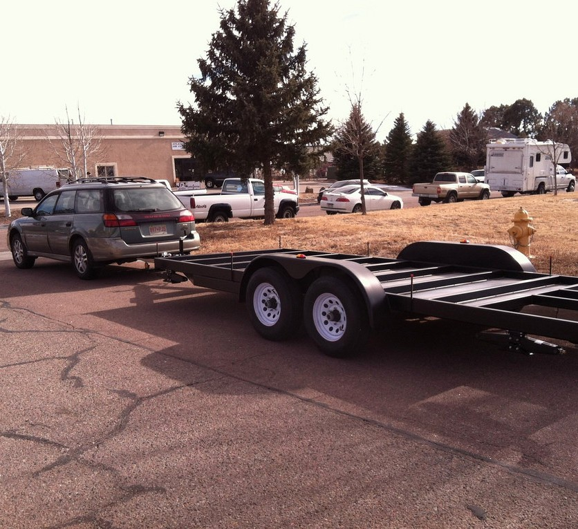 Subaru towing an 18' tiny house trailer